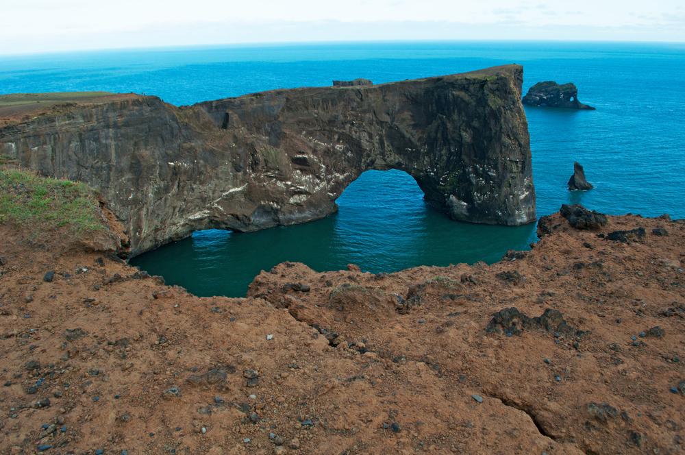 rock arch of Dyrholaey_447633751