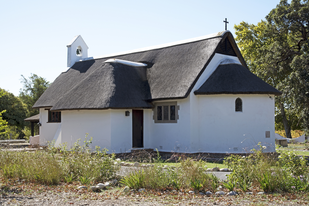 thatched Christian Church of St George at Groot Drakenstein _423639421
