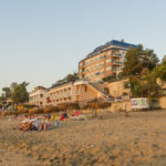 tourists-meet-the-dawn-on-the-beach_349896860