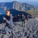unidentified-mountaineers-hike-on-their-way-to-the-peak-rinjani_479075707