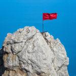 mount-ai-petri-with-a-red-flag-over-black-sea-in-crimea_468876506