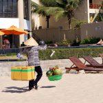 vietnamese-woman-selling-fruits-at-mui-ne-beach_498726310
