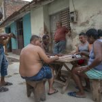 playing dominoes in Trinidad streets_559691749