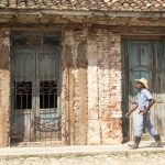 Cuban man walking along the street in trinidad_553090957