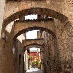 narrow town street in Sirmione, Lake Garda Italy_561401497