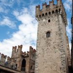 Medieval castle Scaliger in old town Sirmione_561401383