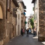 Picturesque narrow town street in Sirmione_561401404