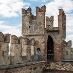 Medieval castle Scaliger in old town Sirmione on lake Lago di Garda_561401332