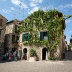 Old house covered by ivy in Sirmione on Garda Lake, Italy_475303612