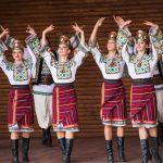 Ukraina School of Dance Ensemble teens dressed in traditional red Ukrainian_549393259
