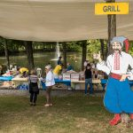 Cossack man with grill sign and picnic area at Ukrainian festival silver spring_516831370