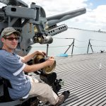 Tourist on the Main Gun on the Bowfin Submarine in Pearl Harbor on the island of Oahu_529267630