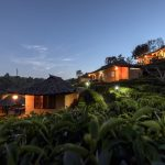 Tea plantation and village at Ban Rak Thai_547268044