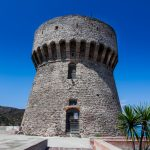 the tower of the port with sea views in capraia_566772394