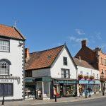 picturesque street of city of Glastonbury, England_329538179