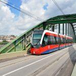 Modern tram passing through Old Sava Bridge_262560092