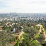 Los Angeles Griffith Park and Downtown LA skyline in the distance._580237990