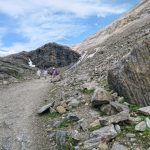 hiker walking along a path at Grossglockner Mountain and Pasterze in Austria_581348578