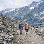 hiker walking along a path at Grossglockner Mountain and Pasterze in Austria_581348533