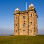 impressive cage monument in winter sunshine on hillside at Lyme Park_581339854