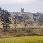 cage monument in winter sunshine on hillside at Lyme Park_581339848