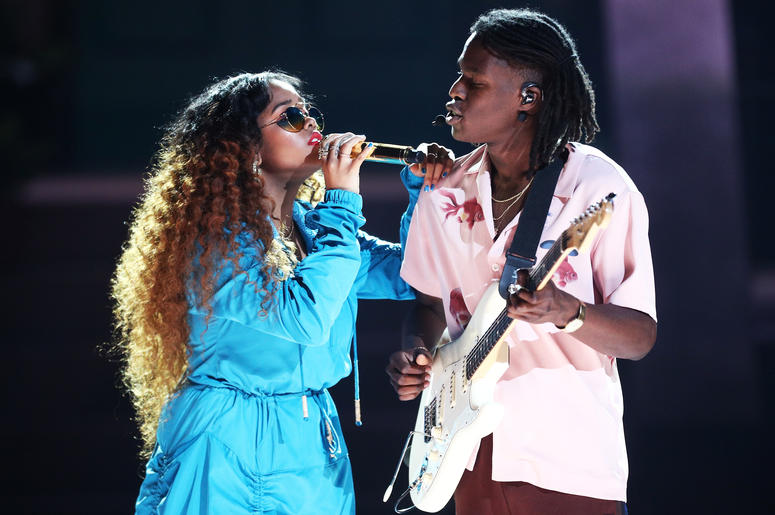 H.E.R. and Daniel Caesar perform onstage at the 2018 BET Awards  (Photo by Frederick M. Brown/Getty Images for BET)