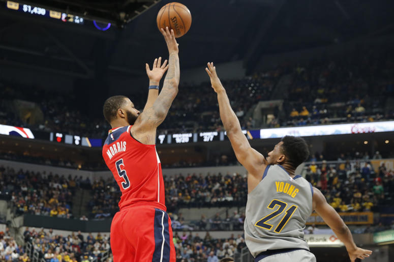 Washington Wizards forward Markieff Morris (5) takes a shot against Indiana Pacers forward Thaddeus Young (21)