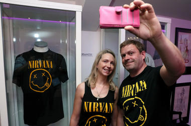 Nirvana fans Tanya and Dave Deegan, from Dublin, take a picture alongside Kurt Cobain's Nirvana smiley face t-shirt at the opening of the 'Growing Up Kurt' exhibition on the life of the Nirvana frontman, at the museum of Style Icons in Newbridge, Ireland.