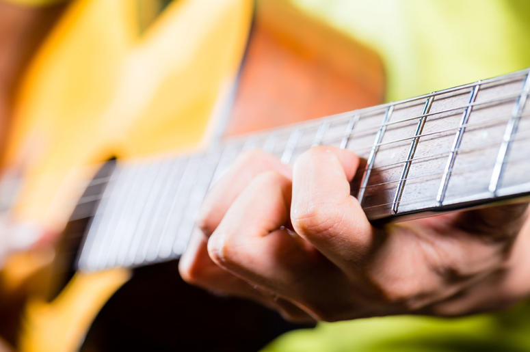guitar-hands-dreamstime_xxl_44838820.jpg
