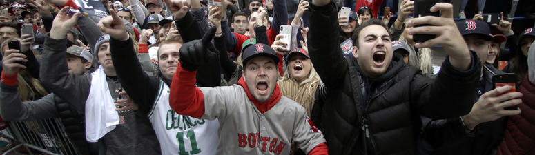 Parade fetes Red Sox; trophy, manager Cora hit by beer cans