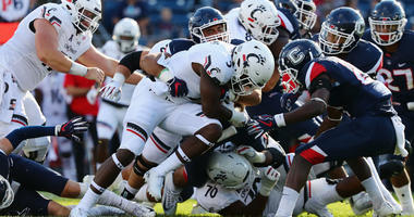 Cincinnati Remains Undefeated With 49-7 Rout Over UConn