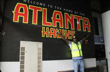 V-103's Greg Street stands against the welcome sign at State Farm Arena prior to opening