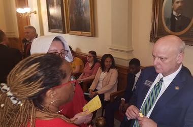 "Atlanta OB-GYN Dr. Hedwige Saint-Lewis (r) is shown trying to convince Senator Brandon Beach to vote against the ""Heartbeat Bill""."