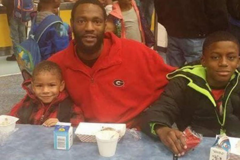 """Autopsy indicates that 32 year old Antonio May (shown with 2 of his 3 sons) died of """"excessive force"""" inside the Fulton County jail on September 11, 2018"""