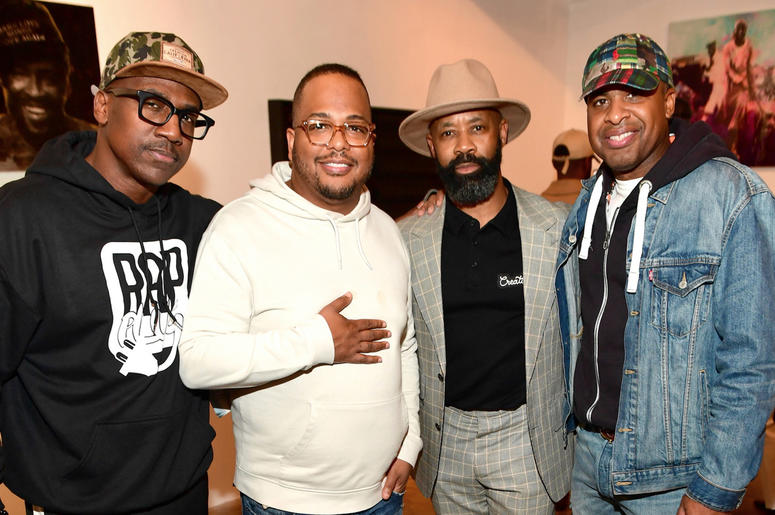 """A group of attendees including ONE Musicfest founder Jay Carter attend Trap Music Museum curator D.L. Warfield's """"My Favorite Things"""" art exhibit on November 30, 2018, in Atlanta."""