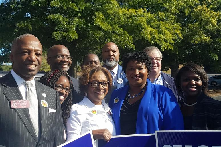 Democratic Gubernatorial Candidate Stacey Abrams is joined by politicians and other supporters after she cast her ballot