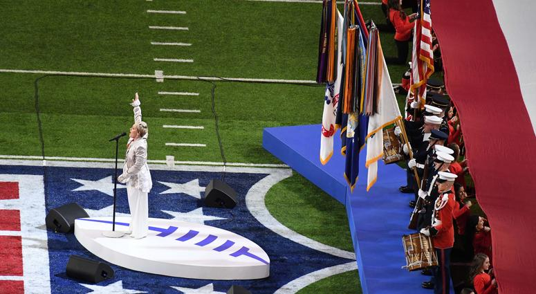 Recording artist Pink performs the national anthem before Super Bowl LII between the Philadelphia Eagles and the New England Patriots at U.S. Bank Stadium.