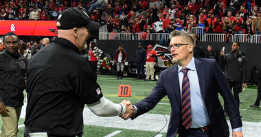Atlanta Falcons head coach Dan Quinn (left) shakes hands with General Manager Thomas Dimitroff