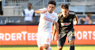 Longshore on United: 'more open to playing long ball'