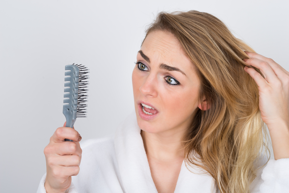 The One Secret Women Only Talk to Their Hairstylist About … Thinning Hair
