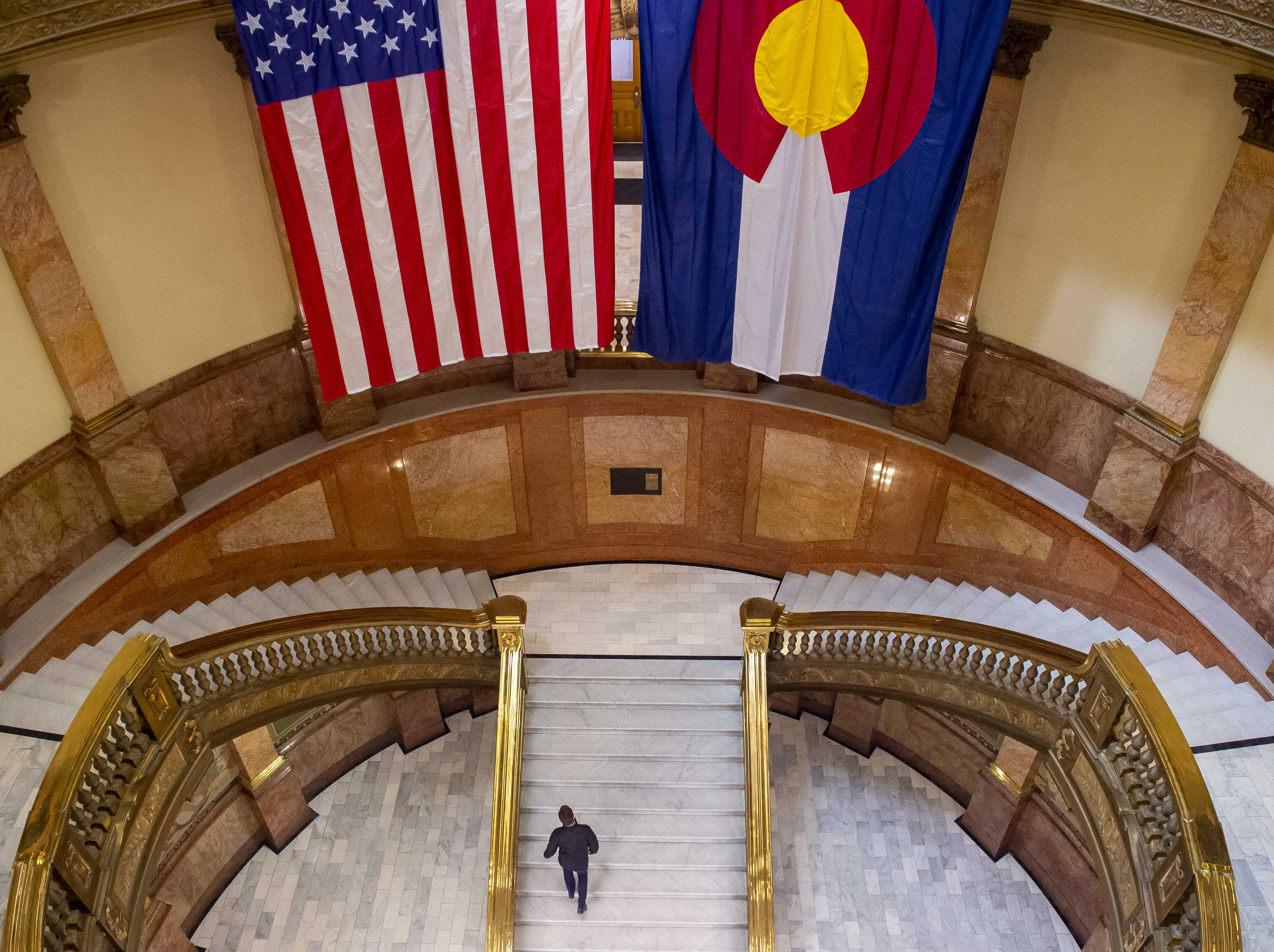 3af151a00e1 A person makes their way up the stairs during the opening day of the  Colorado State Legislature at the Capitol on Friday