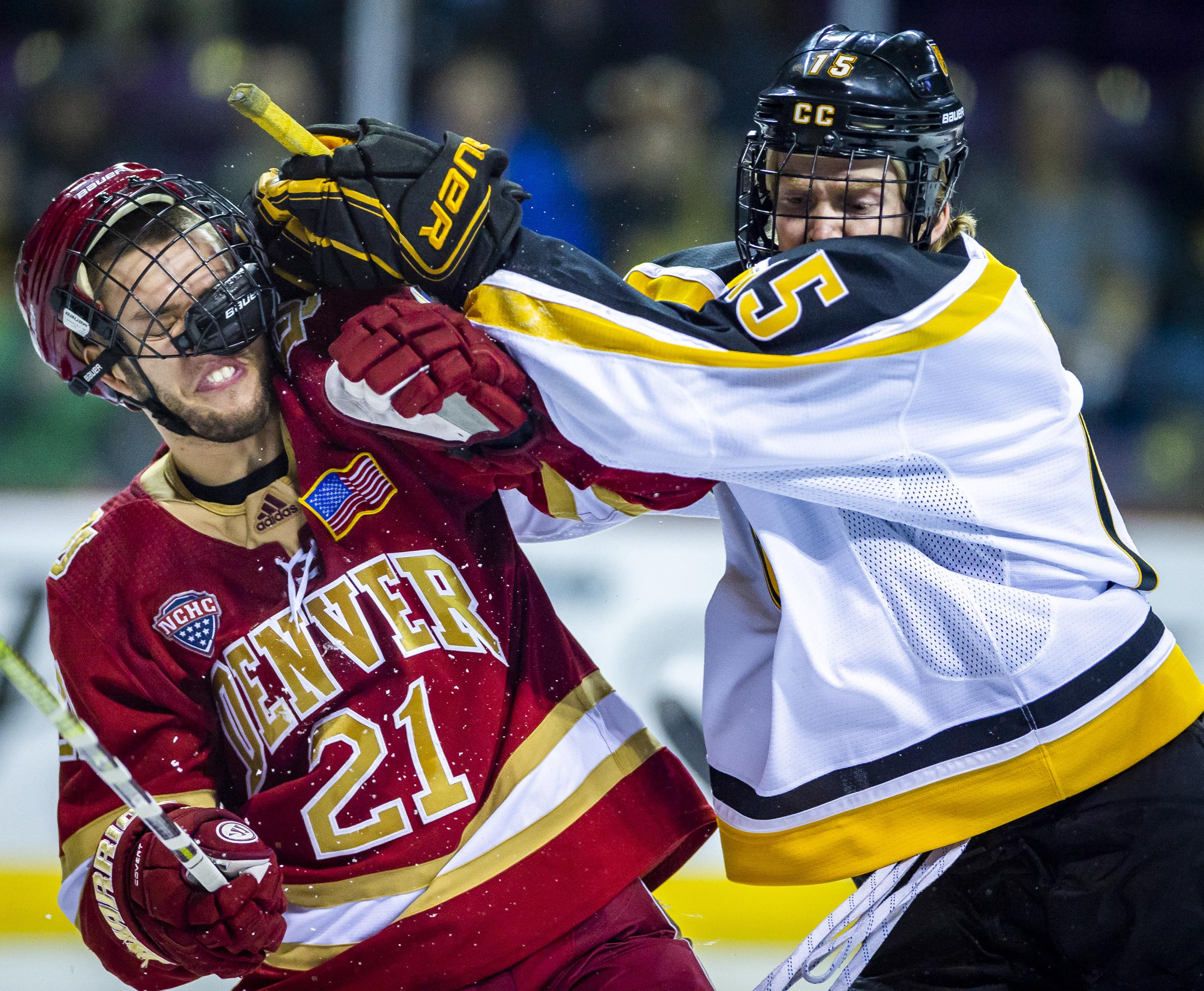 e3b7472f625 University of Denver defenseman Michael Davies gets hit by Colorado College  forward Mason Bergh at the Broadmoor World Arena on Tuesday