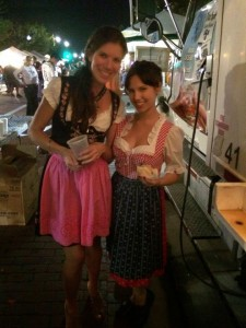 Claudia and Sumalee in dirndls at Oktoberfest send Sumalee to Germany