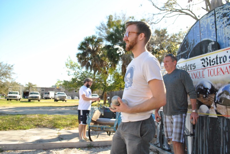 Jeremy playing petanque at Buster's Bistro