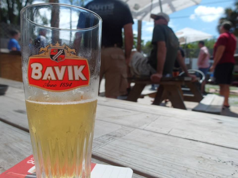 A glass of Bavik at Buster's Bistro during a petanque tournament