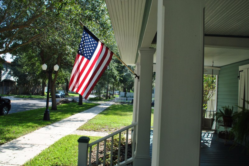 An American flag on a porch that will be featured at Sanford Porchfest