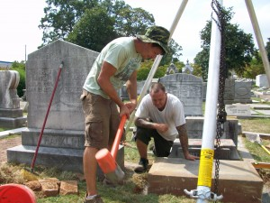 Ronald Hornsby and Dave Westbrook maintain a grave in Oakland Cemetery.  Credit: David Pendered