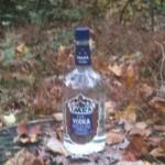 Unopened liquor bottle scrawled with writing.