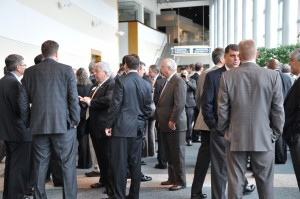"""Inside the Gwinnett Center in Duluth, the crowd mills before the """"State of the County"""" presentation by Gwinnett County commission Chairman Charlotte Nash. Credit: Donita Pendered"""