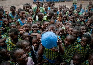 Schoolchildren at the Challenging Heights School in Winneba, Ghana receive the One World Futbol. (Credit: Keri Oberly).
